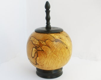 spherical turned wood vessel with lid and finial