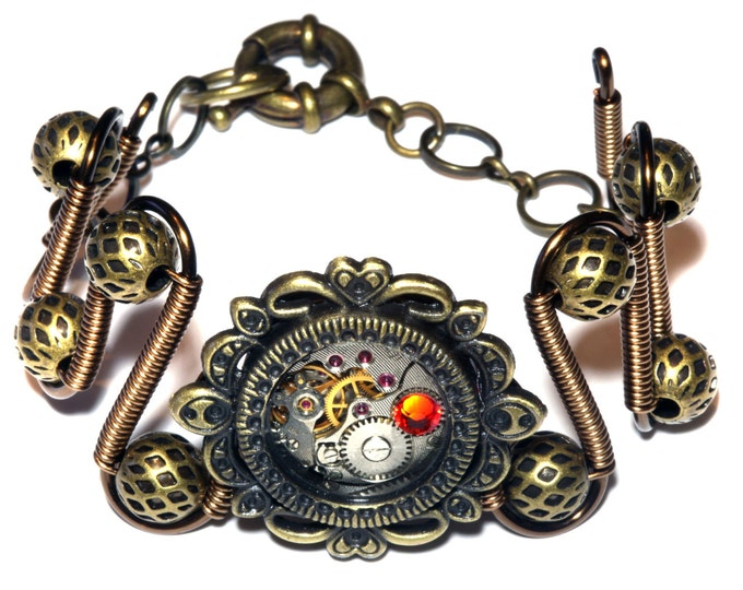 Steampunk Jewelry -  Bracelet - Antique watch movement and fire opal swarovski crystal