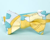 aqua, baby blue, and yellow freestyle bow tie for the little guy
