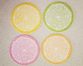 Set of eight assorted citrus letterpress coasters