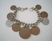 Chunky Coin Bracelet with 9 Foreign Coins 2 Finland 2 Spain 4 Canada 1 New Zealand