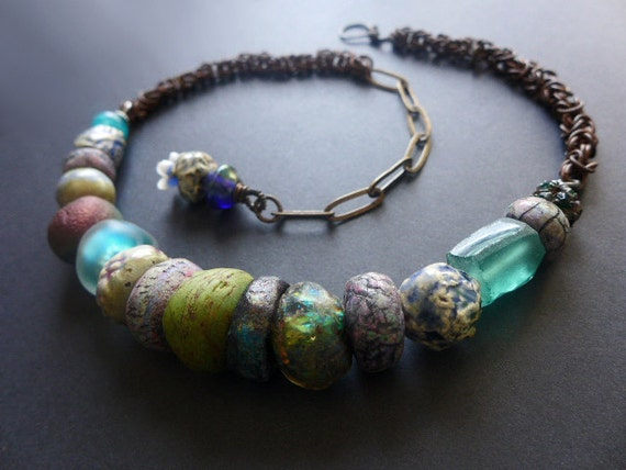 Gigil. Thick and chunky rustic assemblage choker with textured art beads.