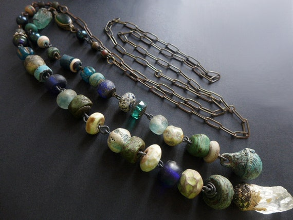 Thaumaturge- A Worker of Marvels. Rustic Victorian tribal assemblage lariat necklace in blues and greens.