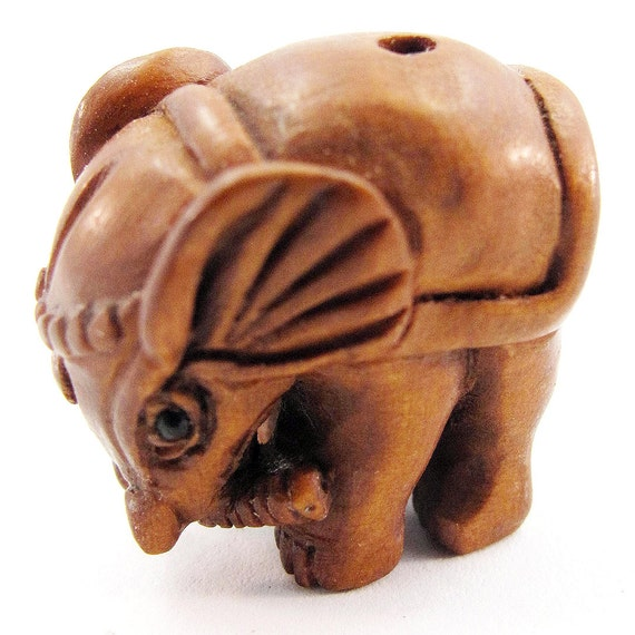Elephant hand carved boxwood ojime bead