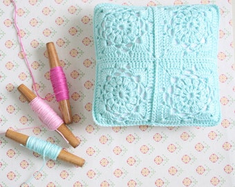 Crochet granny square vintage inspired pillow.