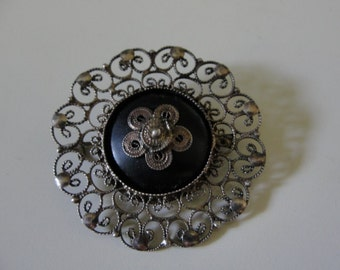 Antique filligree and onyx silver brooch.