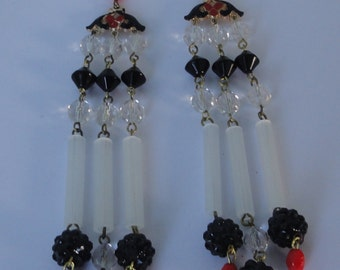 Gold tone with Black, Red, White Beads Shoulder Duster Earrings.