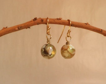 Earrings of tiny ORBS with iridescent shell, pale greens