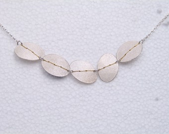 Silver oval 5 disc necklace stitched with gold thread