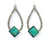 Turquoise earrings set in drop shaped sterling silver