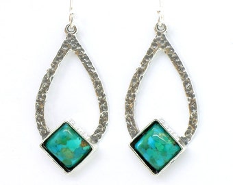 Turquoise earrings set in drop shaped sterling silver
