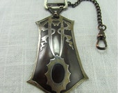 Circa 1910 Arts and Crafts Era Sterling on Copper Watch Fob