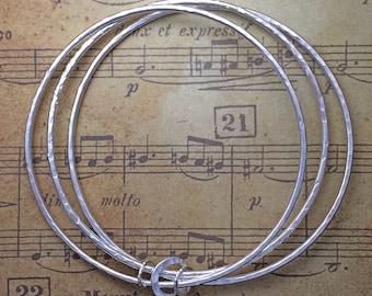 Set of three sterling silver bangles Trio Triple