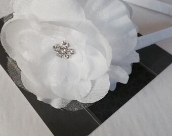 White flower with rhinestone center headband...