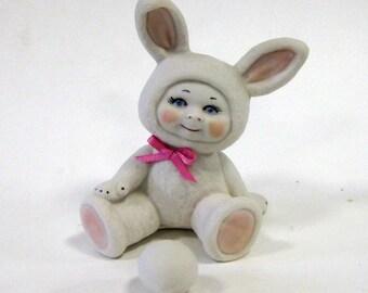 Porcelain Sitting Bunny Kid With Egg