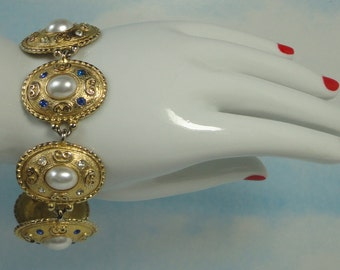 Vintage gold tone with cabochon Faux Pearls, Sapphire Blue and Clear color Rhinestones Bracelet.