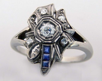 Flowing Beautiful Art Nouveau diamond ring with sapphires