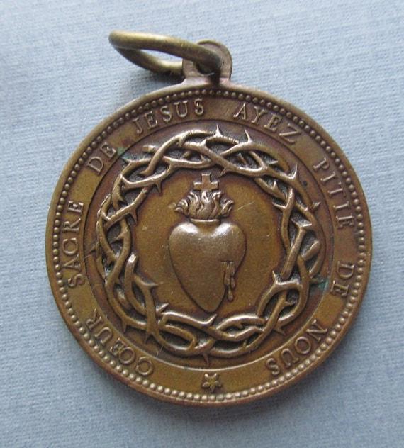 Vintage sacred heart jesus signed medal