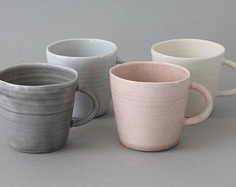 Porcelain Mug made on a wheel