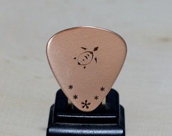 Copper guitar pick with sea turtle
