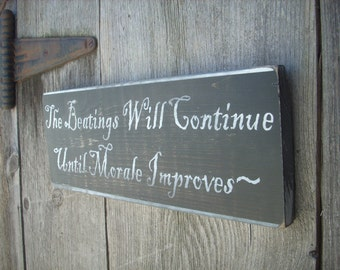 The Beatings will continue until morale improves pirate funny Wooden Shabby Primitive Distressed Sign