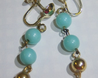 vintage light blue and gold tone dangle and drop clip on earrings 315D