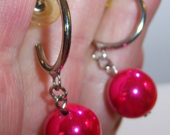 vintage silver tone hoop ish pierced earrings with bright shiny pink dangle round bead 14IN