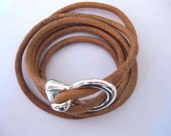 Tan leather wrap bracelet with antique silver clasp