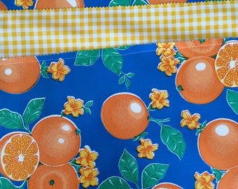 The Floridian---Reversible oilcloth placemats with oranges and yellow gingham