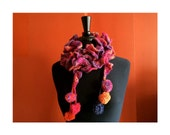 Corkscrew Spiral Ruffle Scarf in Shades of Pink, Purple, and Orange with Pompoms