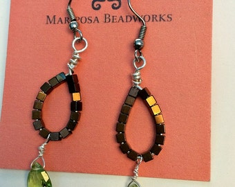 Delicate dangle earrings with a peridot tear drop pendant