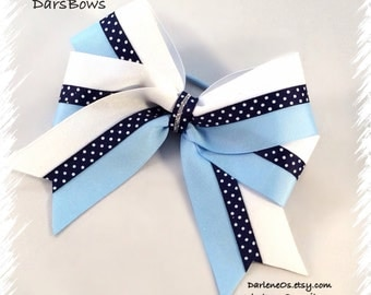 White with Light Blue A Navy Swiss Dot in the Middle and Center Topped with a Strand if Silver Glitter  Hairbow