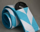 Camera Strap Cover with Lens Pocket - Teal and White Arrows