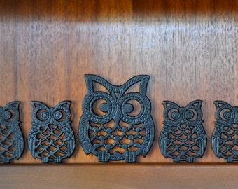vintage cast iron owl trivets - set of five