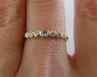 Bezel set 7 diamond ring