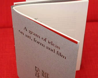 Poetry Object: UN/SPOOL double-titled book after Maya Deren's 'Meshes of the Afternoon'