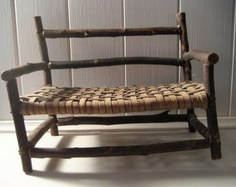 miniature handmade twig bench with woven seat