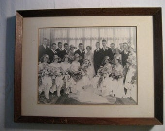 1927 black and white photograph of a large wedding party