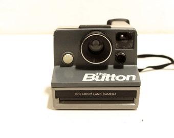 POLAROID camera THE BUTTON vintage grey on grey Sx-70 camera