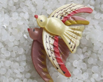Vintage brooch , 1920s celluloid duo of birds