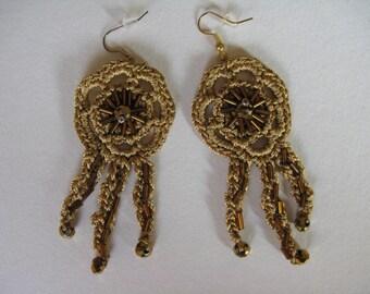 Beautiful crocheted green silk pendant earrings  in ochre, golden brown, copper, flower, golden brown glass tube beads, golden yellow pearls