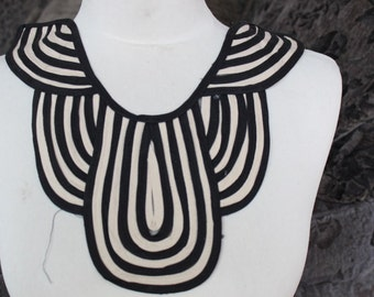 Cute embroidered  applique  black and  ivory color 1 pieces listing 16 inches wide at the neck 5 inches long at the center