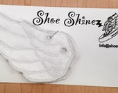 White On shoe wings