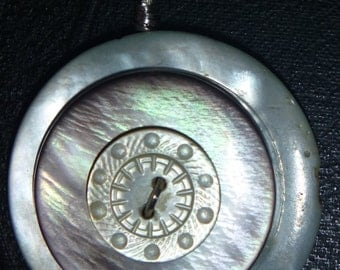 Three Vintage shell and mother of pearl buttons carved pendant.