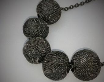 Gunmetal chain and  metal beads necklace.