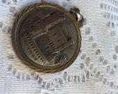Vintage 1960's brass Monoco coin pendant