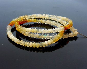 Smooth polished ethiopian opal rondelle beads 3-4mm 1/2 strand