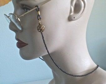 Black and gold beaded eyeglass/sunglass holder