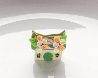 Miniature fairy cottage in peach, yellow and green handmade from polymer clay