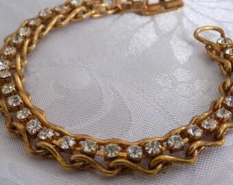 Vintage bracelet, 7 inch crystal and unique gold plate tennis bracelet, elegant hinged bracelet